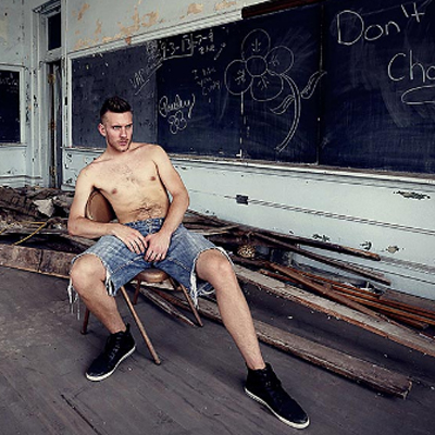 Hot men photographed in abandoned schools.
