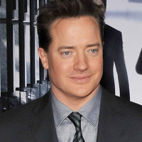 Brendan Fraser says he was manhandled by Hollywood honcho.