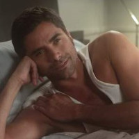 John Stamos showcases how to cuddle a man!