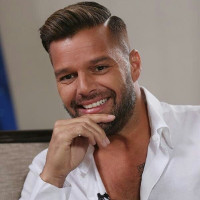 Ricky Martin joins mass protest against Puerto Rico's anti-LGBT governor.